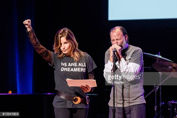 Actors Gina Gershon and Fisher Stevens speak onstage during The People's State Of The Union at Town Hall on January 29 2018 in New York City