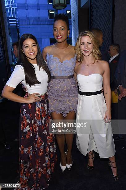 Actors Gina Rodriguez Aisha Tyler and Emily Bett Rickards attend the CW Network's 2015 Upfront at the London Hotel on May 14 2015 in New York City