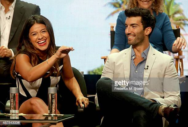 Actors Gina Rodriguez and Justin Baldoni speak onstage at the Jane The Virgin panel during the CW Network portion of the 2014 Summer Television...