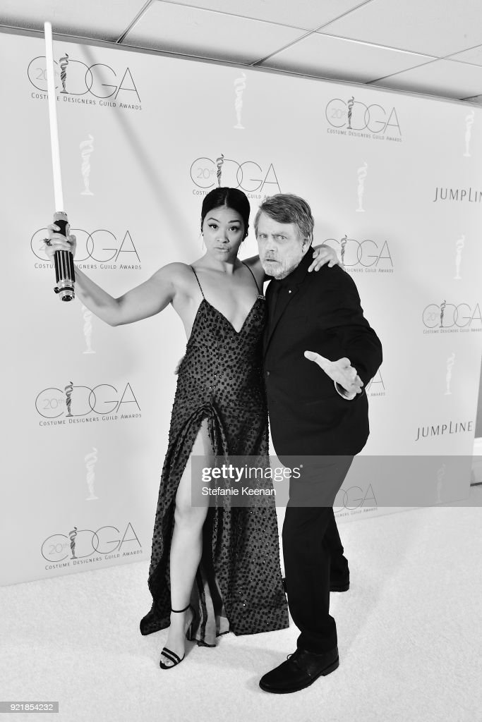 Actors Gina Rodriguez (L) and Mark Hamill attend the Costume Designers Guild Awards at The Beverly Hilton Hotel on February 20, 2018 in Beverly Hills, California.