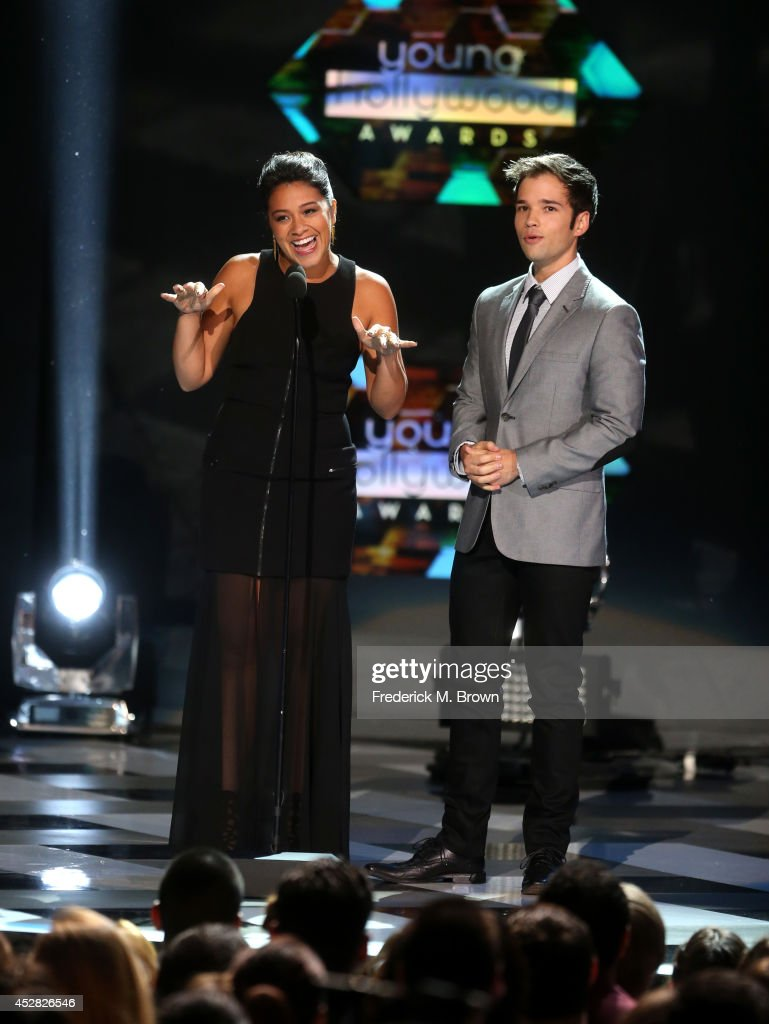 Actors Gina Rodriguez (L) and Nathan Kress speak onstage at the 2014 Young Hollywood Awards brought to you by Samsung Galaxy at The Wiltern on July 27, 2014 in Los Angeles, California. The Young Hollywood Awards will air on Monday, July 28 8/7c on The CW.