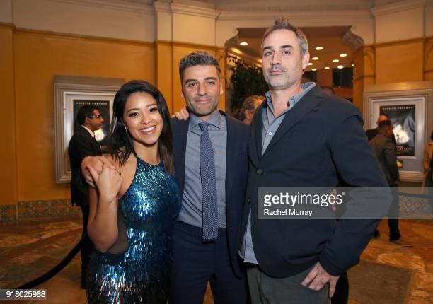 Actors Gina Rodriguez and Oscar Isaac and director/screenwriter Alex Garland attend the Los Angeles Premiere of 'Annihilaton' at Regency Village...