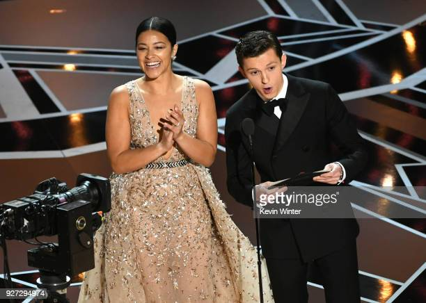 Actors Gina Rodriguez and Tom Holland speak onstage during the 90th Annual Academy Awards at the Dolby Theatre at Hollywood Highland Center on March...