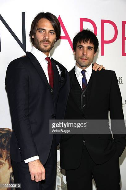 Actors Giulio Berruti and actor Unax Ugalde attend the 'Bon Appetit' Berlin premiere at Astor Film Lounge on November 24 2010 in Berlin Germany