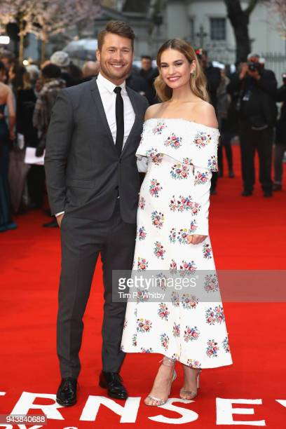 Actors Glen Powell and Lily James attend 'The Guernsey Literary And Potato Peel Pie Society' World Premiere at The Curzon Mayfair on April 9 2018 in...