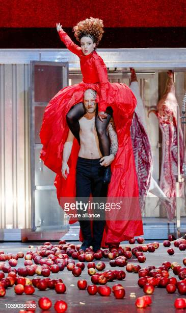 Actors Goetz Schubert as Agamemnon and Maria Schrader as Klytaimnestra perform during the photo rehearsal for Die Rasenden in the play Agamemnon in...