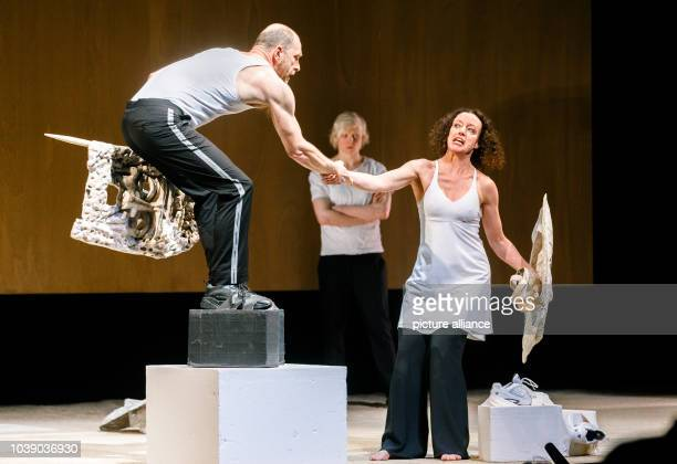 Actors Goetz Schubert as Agamemnon Anne Müller as Iphigenie and Maria Schrader as Klytaimnestra perform during the photo rehearsal for Die Rasenden...