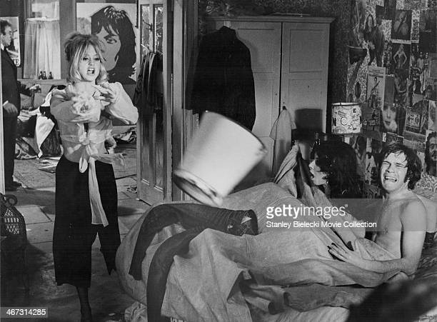 Actors Goldie Hawn and Nicky Henson in a scene from the movie 'There's a Girl in My Soup' 1970