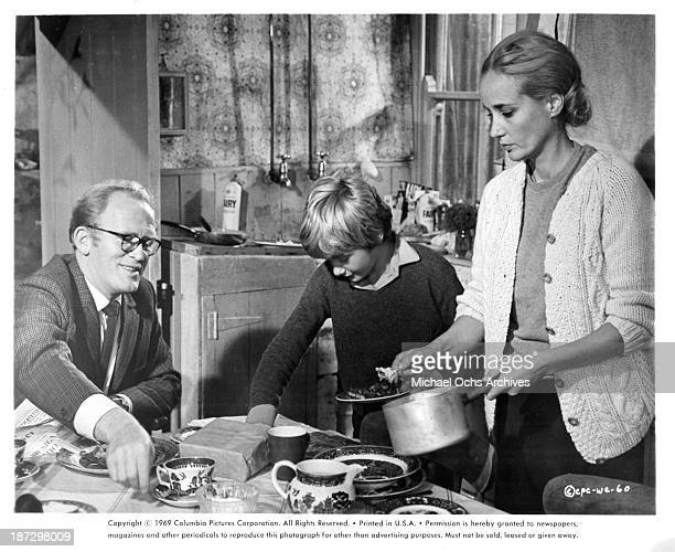 """Actors Gordon Jackson, Mark Lester and actress Sylvia Syms on set of the Columbia Pictures movie """"Run Wild, Run Free"""" in 1969."""