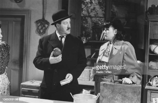 Actors Gordon Kaye and Kirsten Cooke in a scene from the television sitcom ''Allo 'Allo' circa 1985