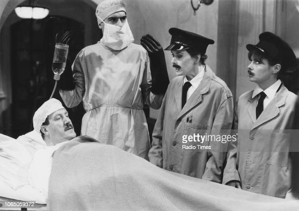 Actors Gordon Kaye Arthur Bostrom Kirsten Cooke and Vicky Michelle in a scene from episode 'The Exploding Bedpan' of the television sitcom ''Allo...