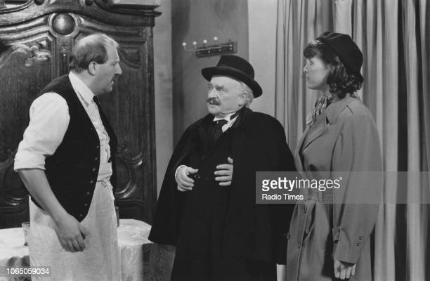 Actors Gordon Kaye Kenneth Connor and Kirsten Cooke in a scene from the television sitcom ''Allo 'Allo' December 13th 1987