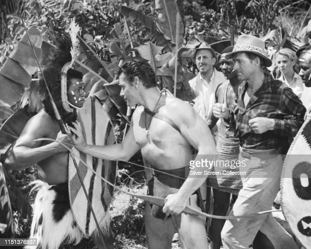 Actors Gordon Scott as Tarzan Jock Mahoney as Coy Banton Betta St John as Fay Ames and Lionel Jeffries as Ames in the film 'Tarzan the Magnificent'...