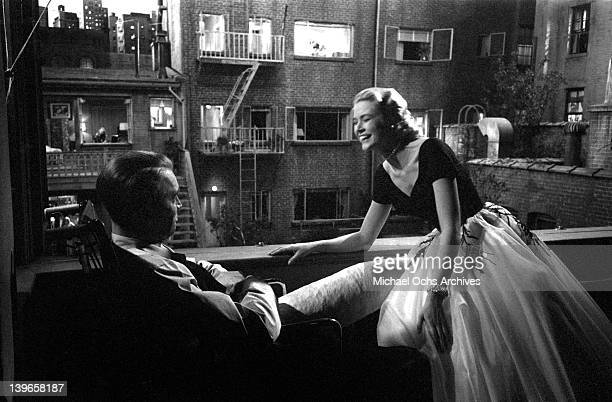 Actors Grace Kelly and Jimmy Stewart share a joke on the set of the Paramount Pictures movie 'Rear Window' in November 1953 in Los Angeles California