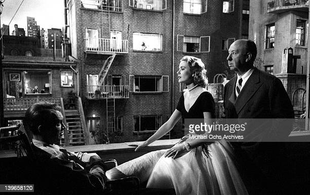 Actors Grace Kelly and Jimmy Stewart with director Alfred Hitchcock on the set of the Paramount Pictures movie 'Rear Window' in November 1953 in Los...