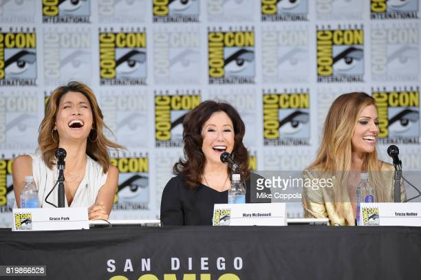 Actors Grace Park Mary McDonnell and Tricia Helfer speak onstage at SYFY 'Battlestar Galactica' Reunion during ComicCon International 2017 at San...