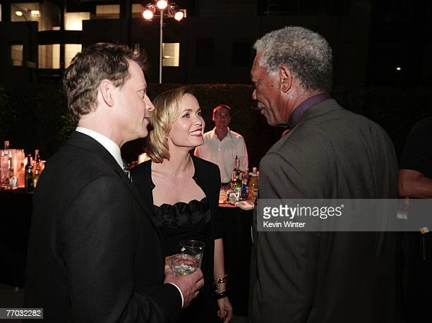 Actors Greg Kinnear Radha Mitchell and Morgan Freeman chat during the afterparty for the premiere of MGM's Feast of Love at the Academy of Motion...