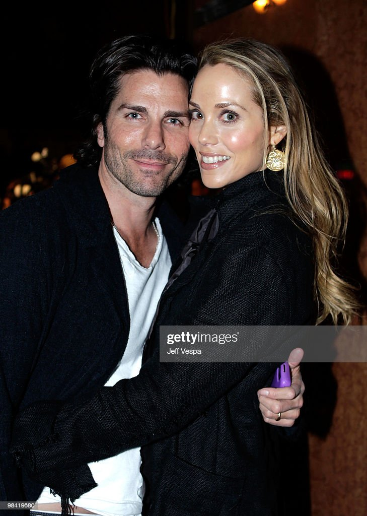 Actors Greg Lauren and Elizabeth Berkley arrive at Banksy's 'Exit Through The Gift Shop' premiere at Los Angeles Theatre on April 12, 2010 in Los Angeles, California.