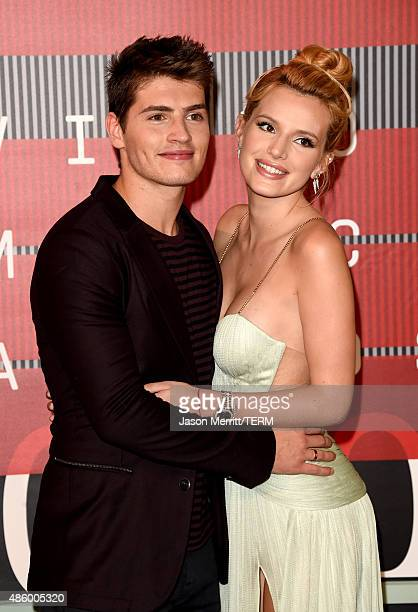 Actors Gregg Sulkin and Bella Thorne attend the 2015 MTV Video Music Awards at Microsoft Theater on August 30 2015 in Los Angeles California