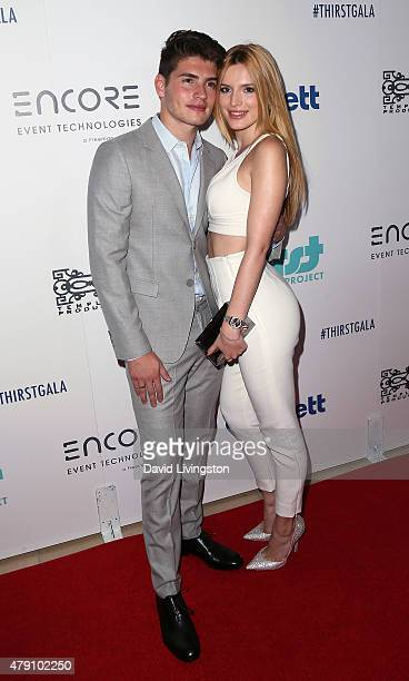 Actors Gregg Sulkin and Bella Thorne attend the 6th Annual Thirst Gala at The Beverly Hilton Hotel on June 30 2015 in Beverly Hills California