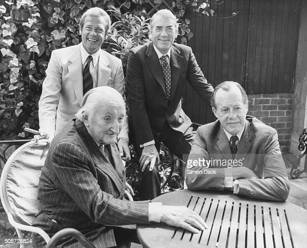 Actors Gregory Peck and Roger Moore stars of the film 'Sea Wolves' pictured meeting two real life Sea Wolves Colin McKenzie and Major General Lewis...