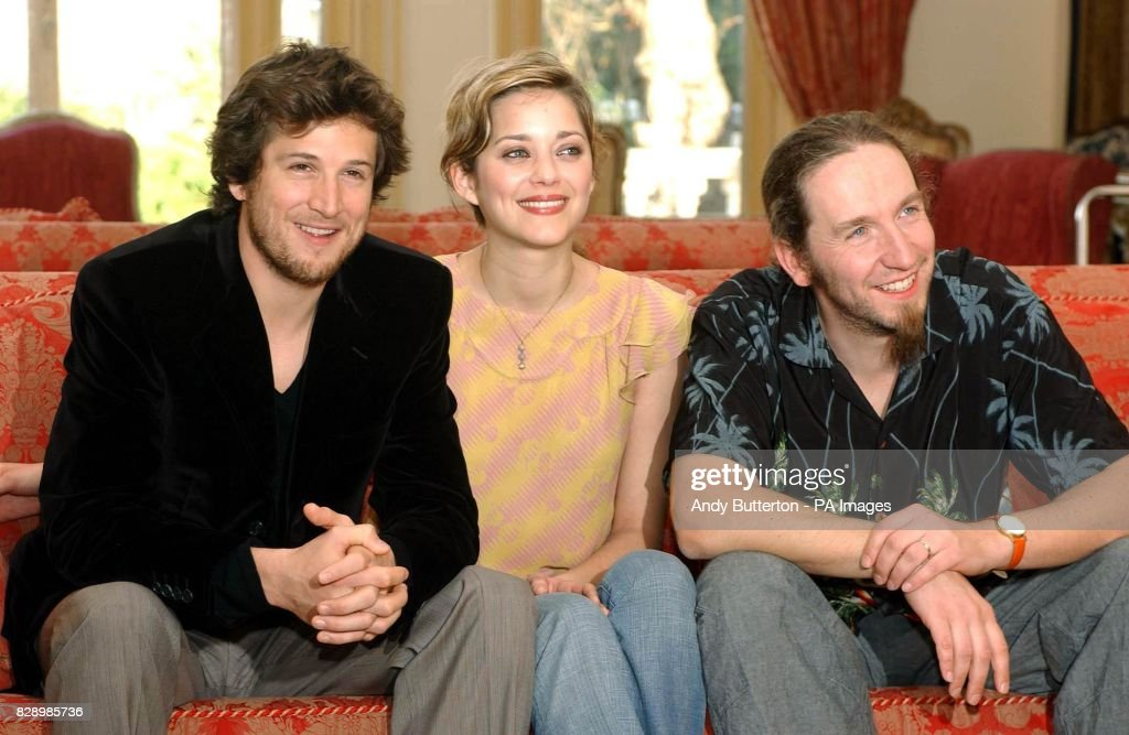 actors Guillaume Canet and Marion Cotillard with director Yann Samuell, during a photocall to launch the 2004 Renault French Film Season at the French Ambassador's Residence in Kensington, west London.