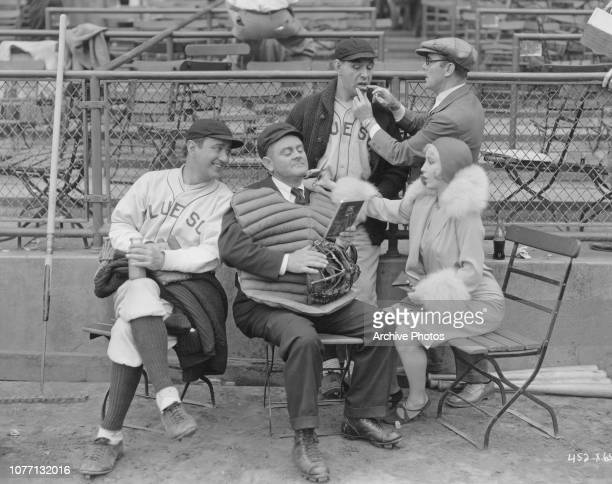 Actors Gus Van of Van and Schenck and actress Bessie Love on the set of the film 'They Learned About Women' 1930
