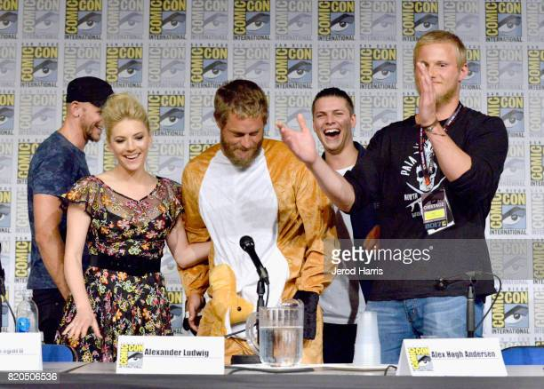 Actors Gustaf Skarsgard Katheryn Winnick Travis Fimmel Alex Hogh Andersen and Alexander Ludwig attend the 'Vikings' panel during San Diego ComicCon...
