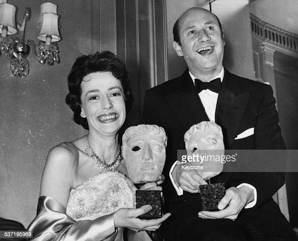 Actors Gwendoline Watford and Donald Pleasance smiling as they hold their BAFTA awards at the ceremony in London December 3rd 1958