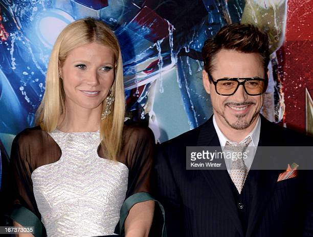 Actors Gwyneth Paltrow and Robert Downey Jr arrive at the premiere of Walt Disney Pictures' 'Iron Man 3' at the El Capitan Theatre on April 24 2013...