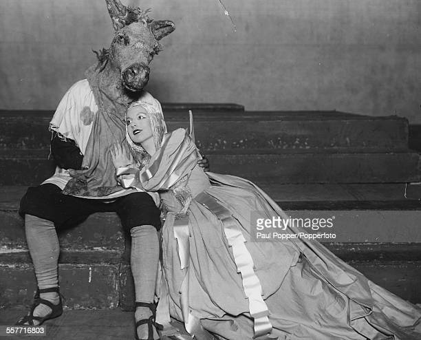 Actors Gyles Isham as 'Bottom' and Adele Dixon as 'Titania' during rehearsals for the play 'A Midsummer Nights Dream' at the Old Vic Theatre London...