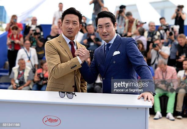 Actors Ha JungWoo and Cho JinWoong attend The Handmaiden photocall during the 69th annual Cannes Film Festival at the Palais des Festivals on May 14...