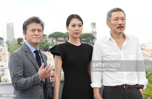Actors Haehyo Kwon Kim Min Hee and Director Hong SangSoo attend the 'The Day After ' photocall during the 70th annual Cannes Film Festival at Palais...
