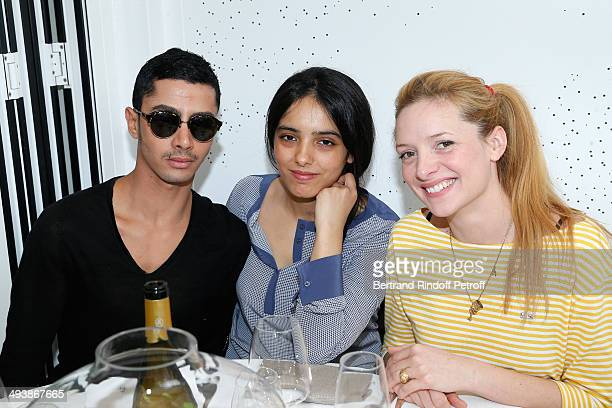 Actors Hafsia Herzi sitting between her brother Djanis Biuzyani and Charlie Bruneau attend the Tennis French Open 2014 Day 1 at Roland Garros on May...