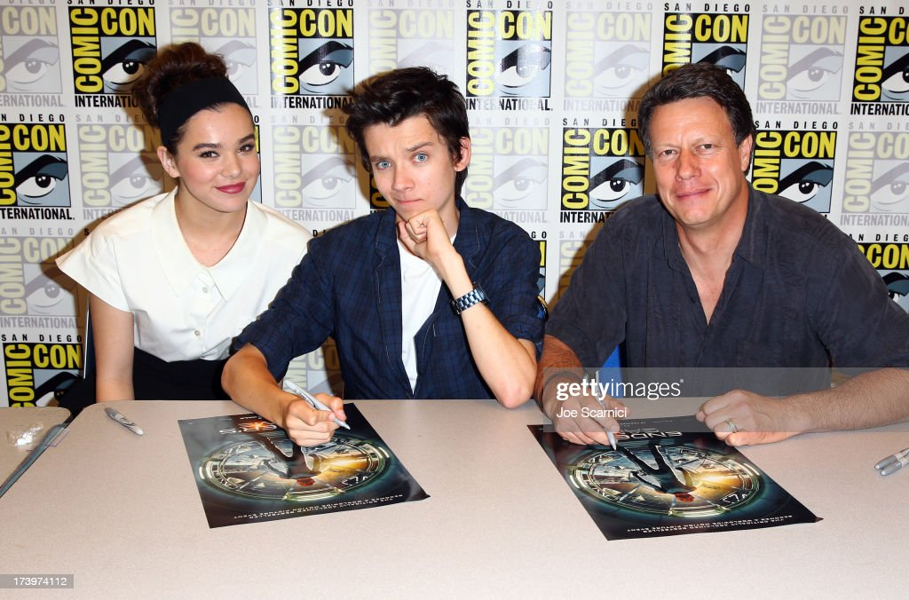 Actors Hailee Steinfeld, Asa Butterfield, and director Gavin Hood speak onstage at the 'Ender's Game' press conference during Comic-Con International 2013 at San Diego Convention Center on July 18, 2013 in San Diego, California.