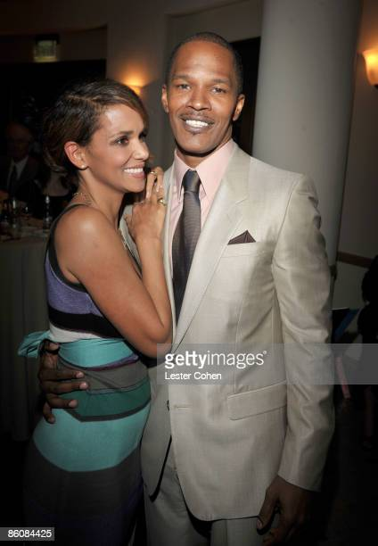 Actors Halle Berry and Jamie Foxx arrive on the red carpet of The Soloist premiere at the Paramount Theatre on April 20 2009 in Hollywood California
