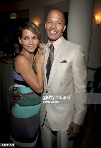 Actors Halle Berry and Jamie Foxx arrives on the red carpet of The Soloist premiere at the Paramount Theatre on April 20 2009 in Hollywood California