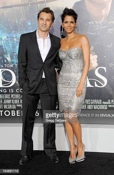 Actors Halle Berry and Olivier Martinez arrive at the Los Angeles premiere of 'Cloud Atlas' at Grauman's Chinese Theatre on October 24 2012 in...