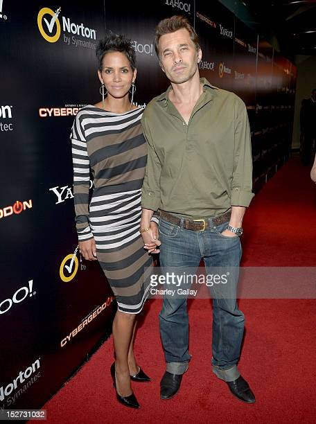 Actors Halle Berry and Olivier Martinez attend the Cybergeddon Premiere at Pacific Design Center on September 24 2012 in West Hollywood California