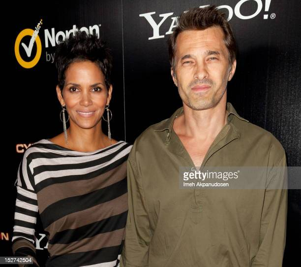 Actors Halle Berry and Olivier Martinez attend the premiere of 'Cybergeddon' at Pacfic Design Center on September 24, 2012 in West Hollywood,...