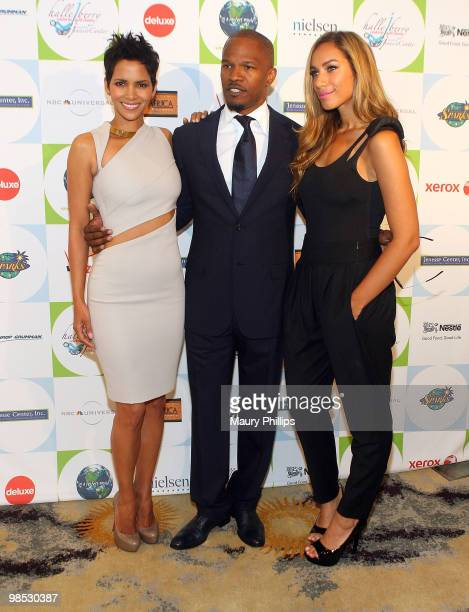 Actors Halle Berry Jamie Foxx and singer Leona Lewis arrive at the 2010 Silver Rose Gala Auction at the Beverly Hills Hotel on April 18 2010 in...