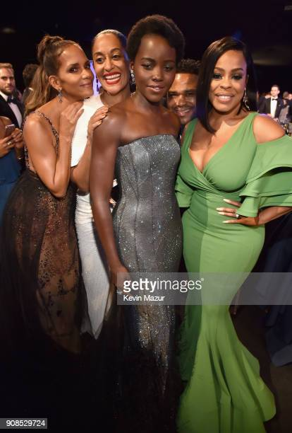 Actors Halle Berry Tracee Ellis Ross Lupita Nyong'o and Niecy Nash pose during the 24th Annual Screen Actors Guild Awards at The Shrine Auditorium on...