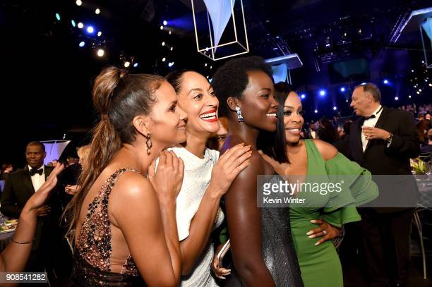 Actors Halle Berry Tracee Ellis Ross Lupita Nyong'o and Niecy Nash attend the 24th Annual Screen Actors Guild Awards at The Shrine Auditorium on...