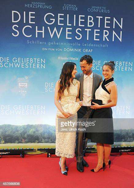 Actors Hannah Herzsprung Florian Stetter and Henriette Confurius pose at the German premiere of the film 'Die geliebten Schwestern' at Cinestar on...