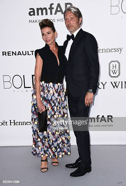 Actors Hanne Jacobsen and Mads Mikkelsen arrive at amfAR's 23rd Cinema Against AIDS Gala at Hotel du CapEdenRoc on May 19 2016 in Cap d'Antibes France