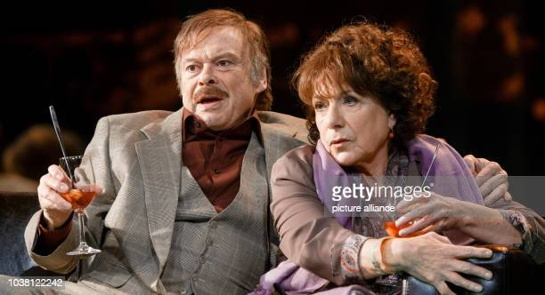 Actors Hannelore Hoger as 'Nathalie Oppenheim' and Volker Lechtenbrink as 'The Mayor' peform on stage during a photo rehearsal of the play 'Ihre...