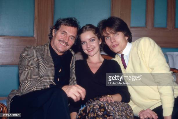 Actors Harald Leipnitz , Dietlinde Turban and Alfon Haiser on a sofa, Germany, 1980s.