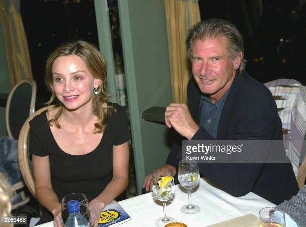 Actors Harrison Ford and actress Calista Flockhart pose at the party after The Actor's Fund of America's presentation of All About Eve featuring an...