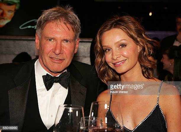 Actors Harrison Ford and Calista Flockhart pose during the 33rd AFI Life Achievement Award tribute to George Lucas at the Kodak Theatre on June 9,...
