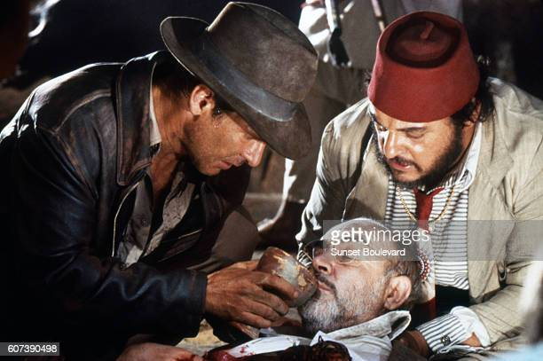 Actors Harrison Ford John RhysDavies and Sean Connery on the set of 'Indiana Jones and the Last Crusade'